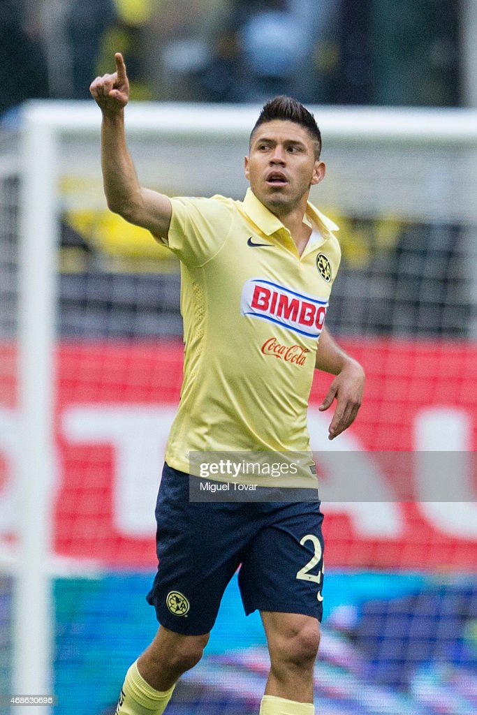 <a gi-track='captionPersonalityLinkClicked' href=/galleries/search?phrase=Oribe+Peralta&family=editorial&specificpeople=2496229 ng-click='$event.stopPropagation()'>Oribe Peralta</a> of America celebrates after scoring during a match between America and Cruz Azul as part of 12th round Clausura 2015 Liga MX at Azteca Stadium on April 04, 2015 in Mexico City, Mexico.
