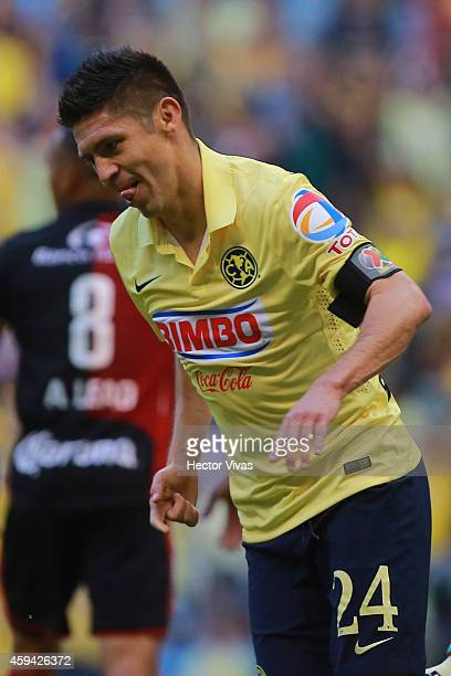 Oribe Peralta of America celebrates after scoring the first goal of his team during a match between America and Atlas as part of 17th round Apertura...