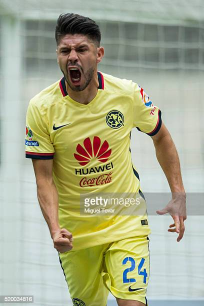 Oribe Peralta of America celebrates after scoring the first goal of his team during the 13th round match between America and Tijuana as part of the...