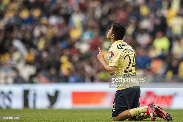 Oribe Peralta of America celebrates after scoring the fourth goal of his team during a match between America and Chiapas as part of 6th round...