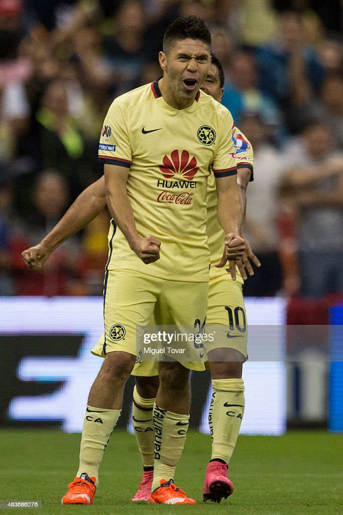 <a gi-track='captionPersonalityLinkClicked' href=/galleries/search?phrase=Oribe+Peralta&family=editorial&specificpeople=2496229 ng-click='$event.stopPropagation()'>Oribe Peralta</a> of America celebrates after scoring the second goal of his team during a 4th round match between America and Dorados as part of the Apertura 2015 Liga MX at Azteca Stadium on August 11, 2015 in Mexico City, Mexico.