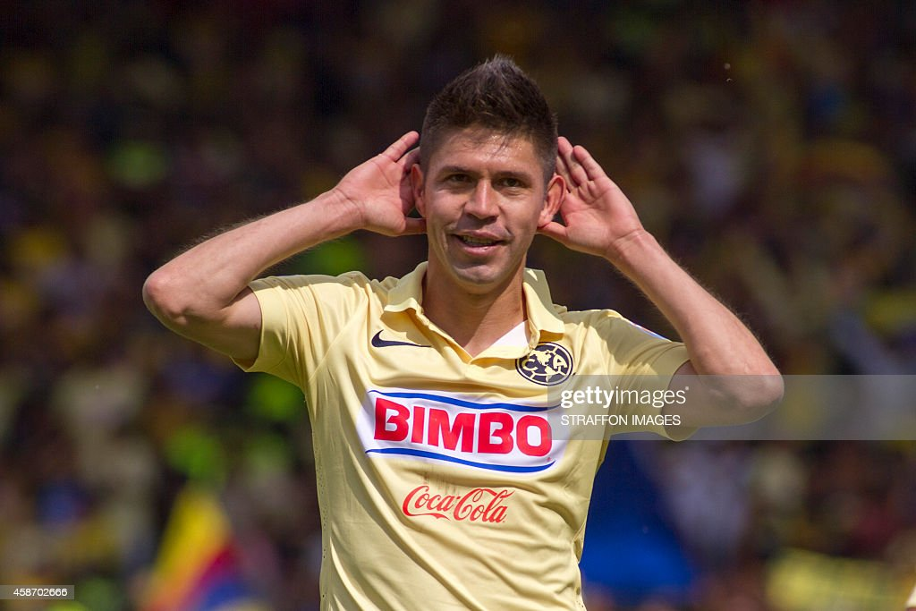 <a gi-track='captionPersonalityLinkClicked' href=/galleries/search?phrase=Oribe+Peralta&family=editorial&specificpeople=2496229 ng-click='$event.stopPropagation()'>Oribe Peralta</a> of America celebrates after scoring the second goal against Toluca during a match between Toluca and America as part of 16th round Apertura 2014 Liga MX at Nemesio Diez Stadium on November 09, 2014 in Toluca, Mexico.