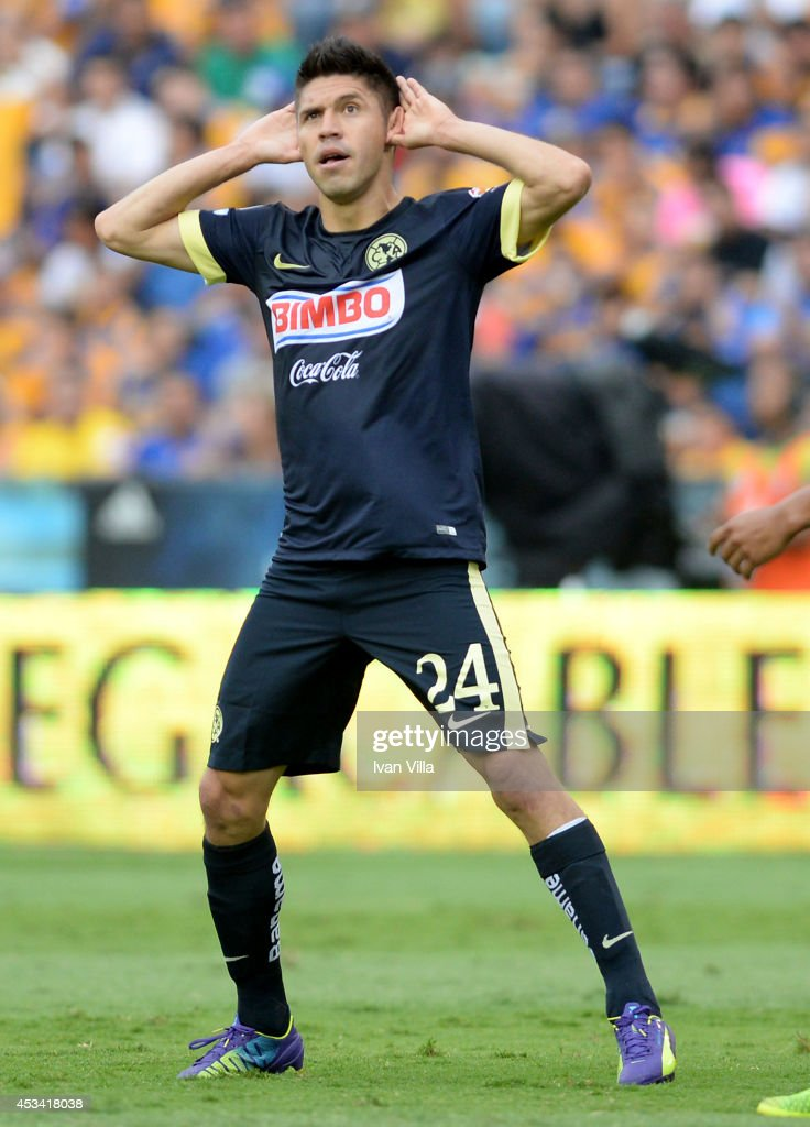 <a gi-track='captionPersonalityLinkClicked' href=/galleries/search?phrase=Oribe+Peralta&family=editorial&specificpeople=2496229 ng-click='$event.stopPropagation()'>Oribe Peralta</a> of America celebrates during a match between Tigres UANL and America as part of 4th round Apertura 2014 Liga MX at Universitario Stadium on August 09, 2014 in Monterrey, Mexico.
