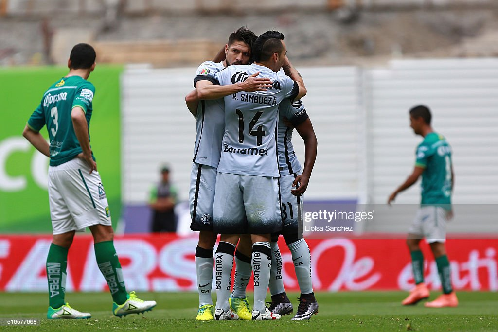 Oribe Peralta of America celebrates with teammates after scoring the first goal of his team during the 11th round match between America and Leon as...
