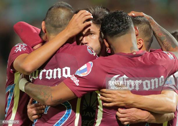 Oribe Peralta of America celebrates with teammates after scoring the first goal of his team during the match between Santos Laguna and America as...