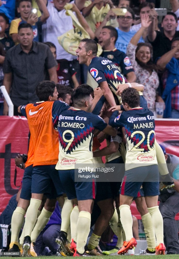 Oribe Peralta of America celebrates with teammates after scoring the first goal of his team during the 4th round match between Atlas and America as part of the Torneo Apertura 2017 Liga MX at Jalisco Stadium on August 11, 2017 in Guadalajara, Mexico.