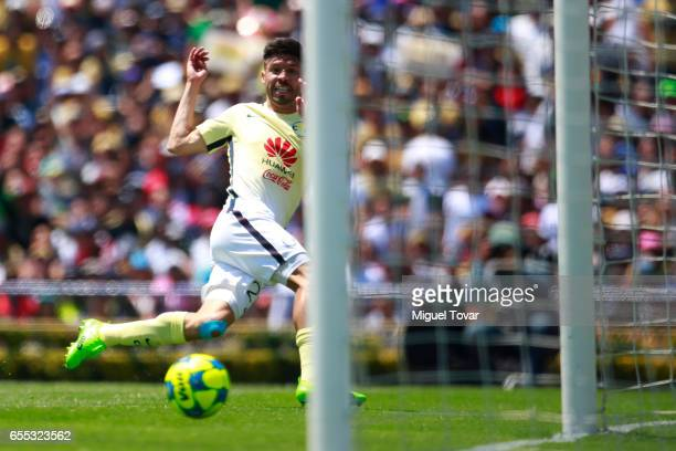 Oribe Peralta of America kicks the ball to score the second goal of his team during the 11st round match between Pumas UNAM and America as par of the...