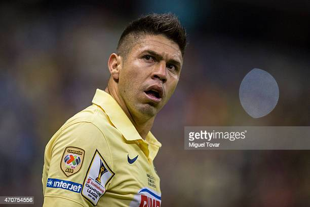 Oribe Peralta of America reacts after scoring the first goal of his team during a Championship first leg match between America and Montreal Impact as...