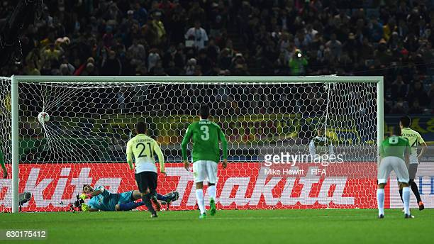 Oribe Peralta of Club America scores his sides second goal from the penalty spot during the FIFA Club World Cup 3rd Place match between Club America...
