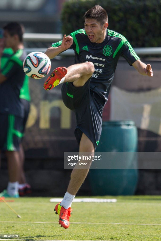 <a gi-track='captionPersonalityLinkClicked' href=/galleries/search?phrase=Oribe+Peralta&family=editorial&specificpeople=2496229 ng-click='$event.stopPropagation()'>Oribe Peralta</a> of Mexican National soccer team controls the ball during a training session at CAR on January 27, 2014 in Mexico City, Mexico. The team is preparing to face Korea in a friendly match before the FIFA World Cup in Brazil.