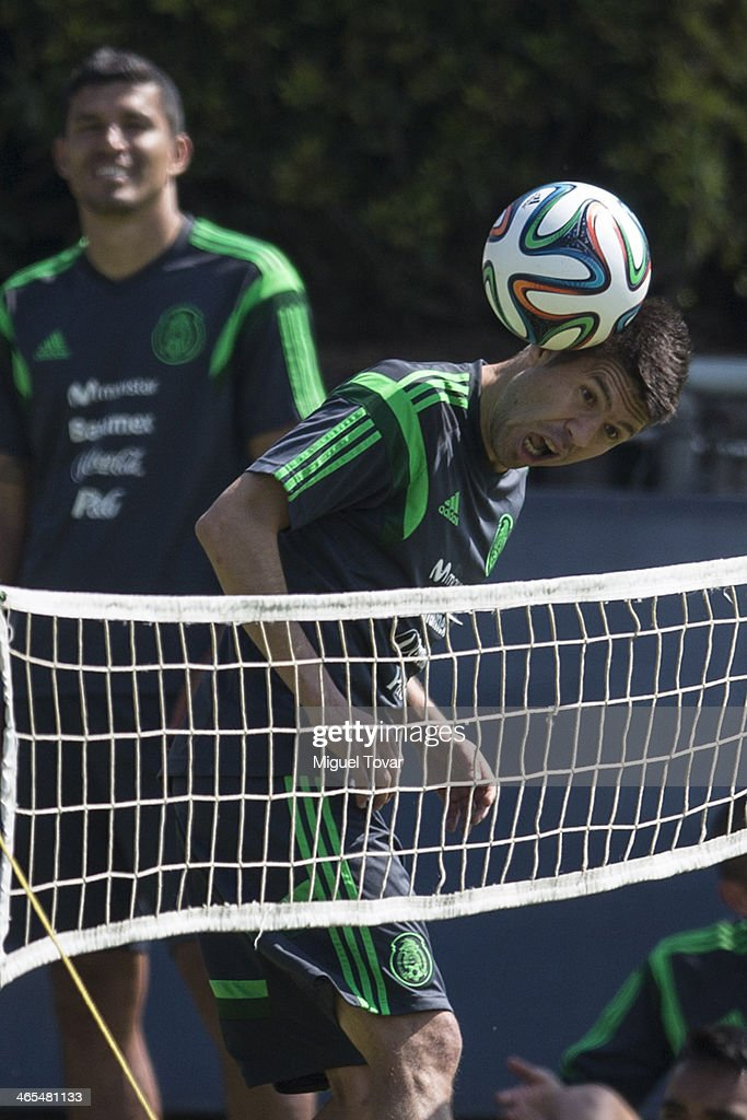 <a gi-track='captionPersonalityLinkClicked' href=/galleries/search?phrase=Oribe+Peralta&family=editorial&specificpeople=2496229 ng-click='$event.stopPropagation()'>Oribe Peralta</a> of Mexican National soccer team heads the ball during a training session at CAR on January 27, 2014 in Mexico City, Mexico. The team is preparing to face Korea in a friendly match before the FIFA World Cup in Brazil.