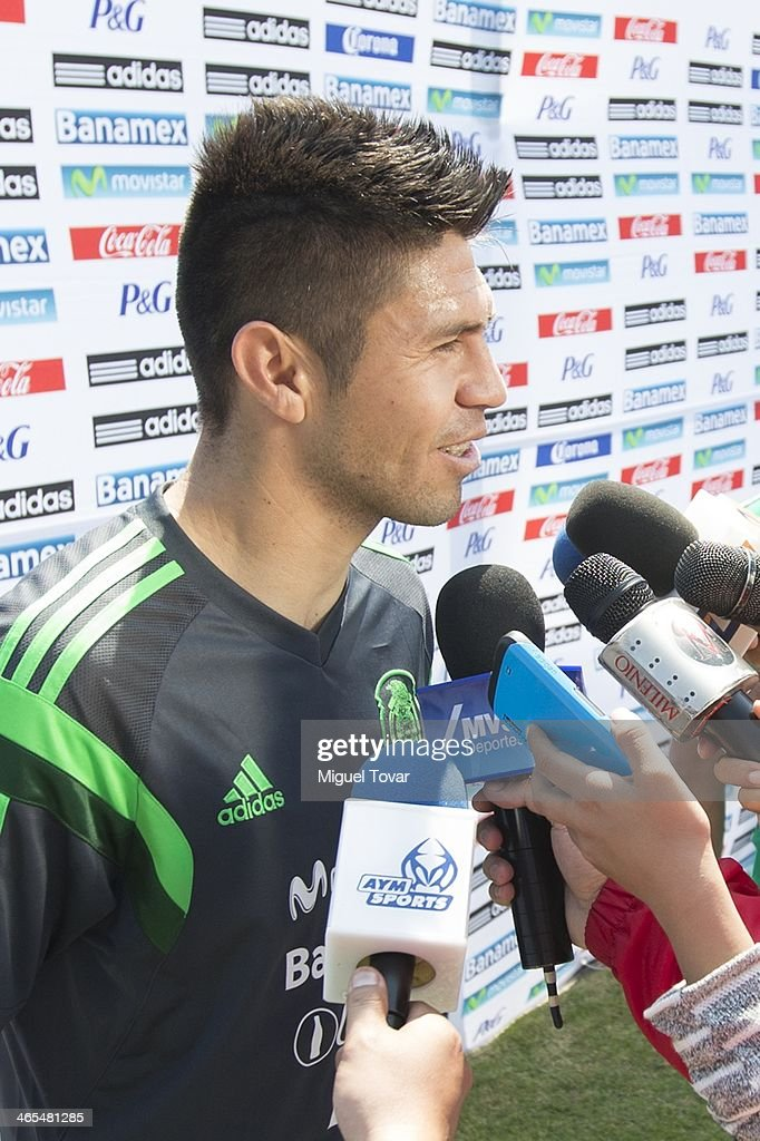 <a gi-track='captionPersonalityLinkClicked' href=/galleries/search?phrase=Oribe+Peralta&family=editorial&specificpeople=2496229 ng-click='$event.stopPropagation()'>Oribe Peralta</a> of Mexican National soccer team talks with media during a training session at CAR on January 27, 2014 in Mexico City, Mexico. The team is preparing to face Korea in a friendly match.