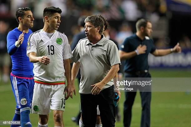 Oribe Peralta of Mexico and Hernan Gomez coach of Panama talk aftera semi final match between Mexico and Panama as part of Gold Cup 2015 at Georgia...