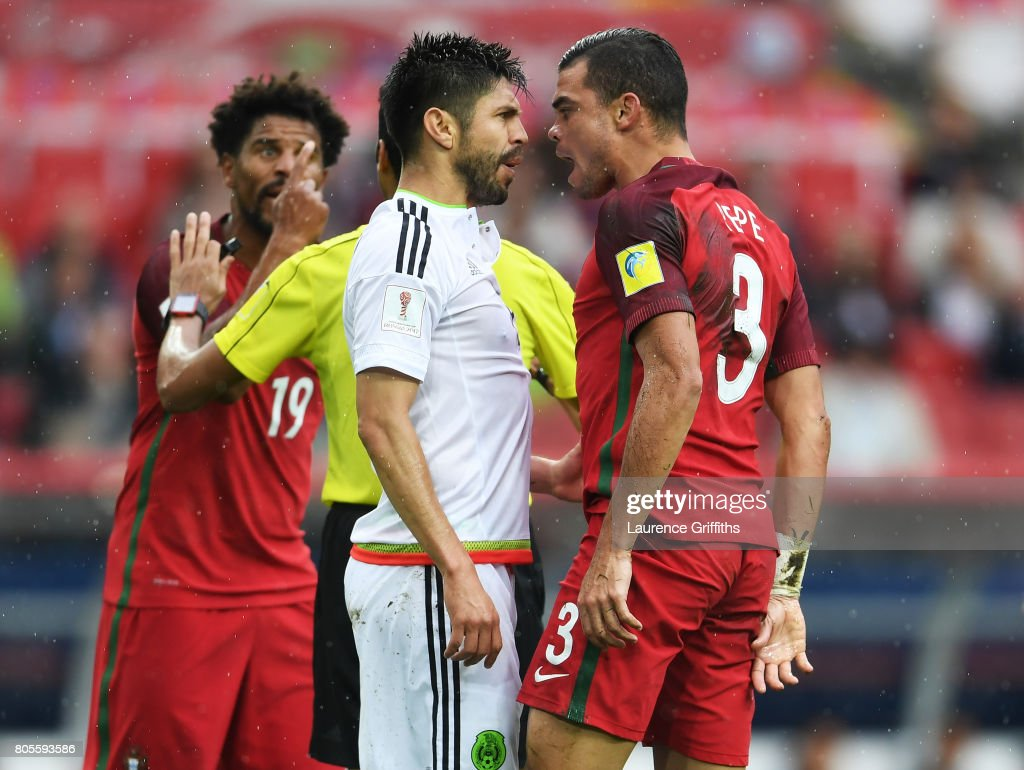 Oribe Peralta of Mexico and Pepe of Portugal confront each other during the FIFA Confederations Cup Russia 2017 Play-Off for Third Place between Portugal and Mexico at Spartak Stadium on July 2, 2017 in Moscow, Russia.