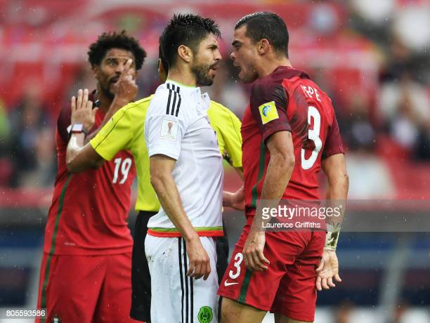 Oribe Peralta of Mexico and Pepe of Portugal confront each other during the FIFA Confederations Cup Russia 2017 PlayOff for Third Place between...