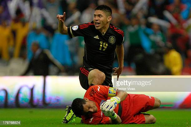 Oribe Peralta of Mexico celebrates a scored goal during a match between Mexico and Honduras as part of the 15th round of the South American...