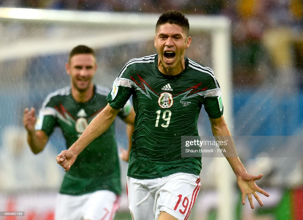 Oribe Peralta of Mexico celebrates after scoring a goal during the 2014 FIFA World Cup Brazil Group A match between Mexico and Cameroon at Estadio das Dunas on June 13, 2014 in Natal, Brazil.