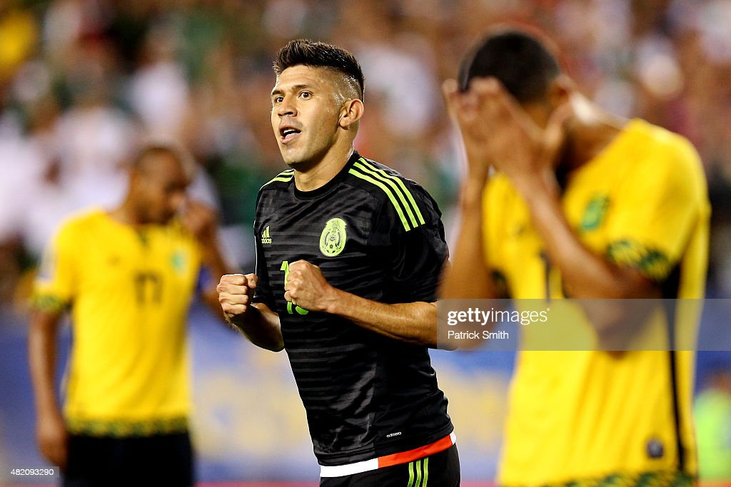 <a gi-track='captionPersonalityLinkClicked' href=/galleries/search?phrase=Oribe+Peralta&family=editorial&specificpeople=2496229 ng-click='$event.stopPropagation()'>Oribe Peralta</a> #19 of Mexico celebrates after scoring against Jamaica in the second half during the CONCACAF Gold Cup Final at Lincoln Financial Field on July 26, 2015 in Philadelphia, Pennsylvania. Mexico won, 3-1.