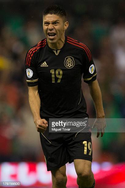 Oribe Peralta of Mexico celebrates after scoring during a match between Mexico and Honduras as part of the 15th round of the South American...