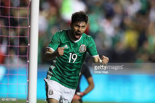 Oribe Peralta of Mexico celebrates after scoring his team's first goal during the International Friendly Match between Mexico and Panama at Toyota...