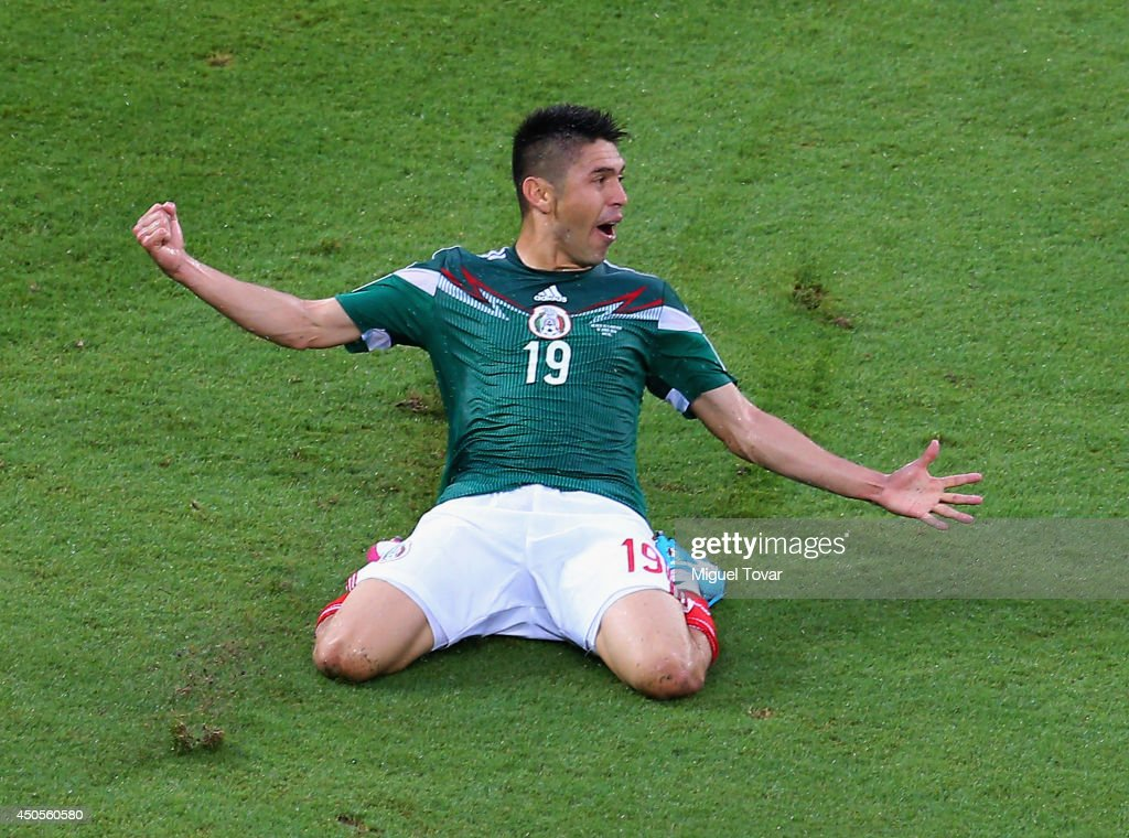 <a gi-track='captionPersonalityLinkClicked' href=/galleries/search?phrase=Oribe+Peralta&family=editorial&specificpeople=2496229 ng-click='$event.stopPropagation()'>Oribe Peralta</a> of Mexico celebrates his goal in the second half during the 2014 FIFA World Cup Brazil Group A match between Mexico and Cameroon at Estadio das Dunas on June 13, 2014 in Natal, Brazil.