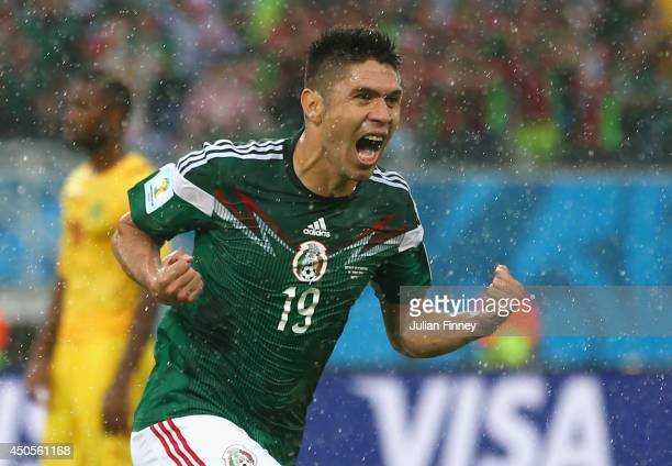 Oribe Peralta of Mexico celebrates his goal in the second half during the 2014 FIFA World Cup Brazil Group A match between Mexico and Cameroon at...