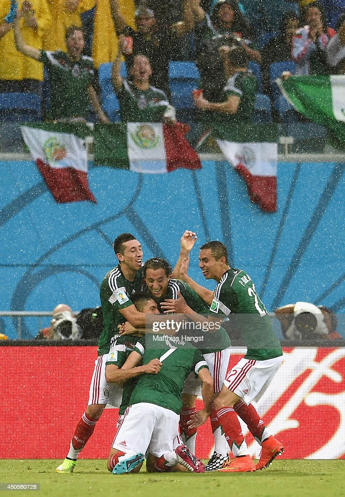 <a gi-track='captionPersonalityLinkClicked' href=/galleries/search?phrase=Oribe+Peralta&family=editorial&specificpeople=2496229 ng-click='$event.stopPropagation()'>Oribe Peralta</a> of Mexico celebrates his goal with teammates in the second half during the 2014 FIFA World Cup Brazil Group A match between Mexico and Cameroon at Estadio das Dunas on June 13, 2014 in Natal, Brazil.