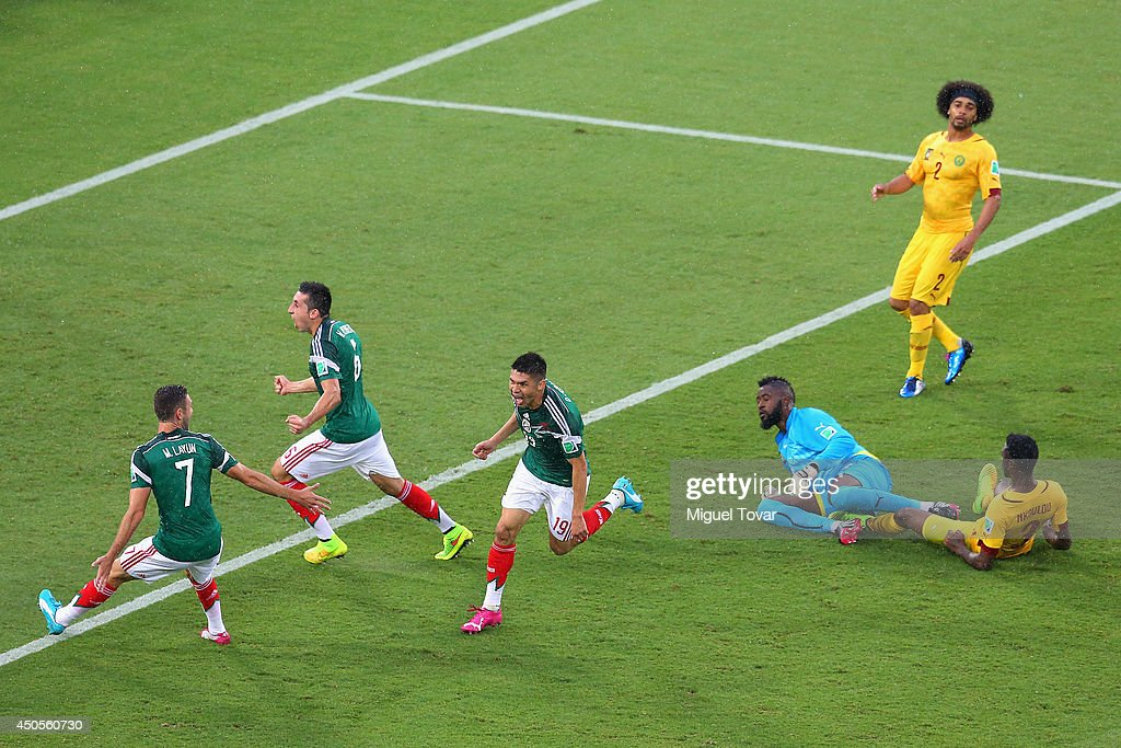 <a gi-track='captionPersonalityLinkClicked' href=/galleries/search?phrase=Oribe+Peralta&family=editorial&specificpeople=2496229 ng-click='$event.stopPropagation()'>Oribe Peralta</a> of Mexico (C) celebrates his goal with teammates Miguel Layun (L) and Hector Herrera (2nd L) as goalkeeper <a gi-track='captionPersonalityLinkClicked' href=/galleries/search?phrase=Charles+Itandje&family=editorial&specificpeople=889524 ng-click='$event.stopPropagation()'>Charles Itandje</a> of Cameroon looks on in the second half during the 2014 FIFA World Cup Brazil Group A match between Mexico and Cameroon at Estadio das Dunas on June 13, 2014 in Natal, Brazil.