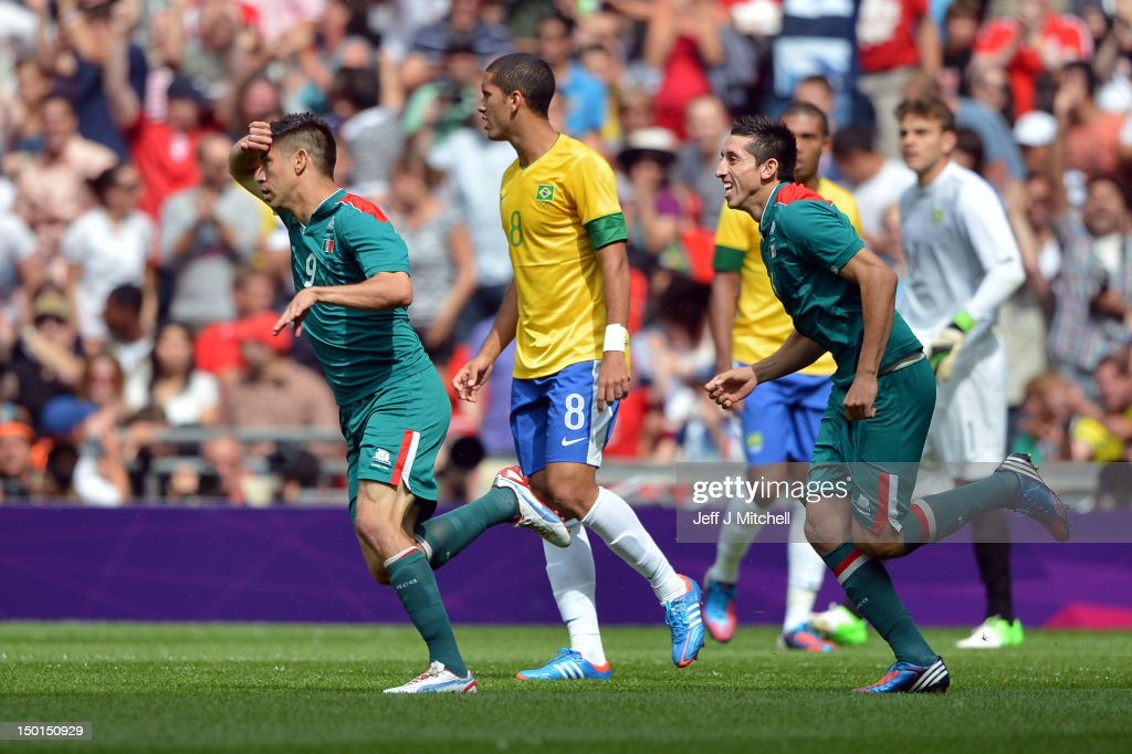 Oribe Peralta of Mexico (L) celebrates scoring the opening goal during the Men's Football Final between Brazil and Mexico on Day 15 of the London 2012 Olympic Games at Wembley Stadium on August 11, 2012 in London, England.