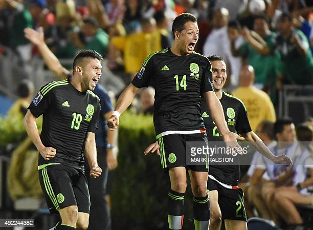 Oribe Peralta of Mexico celebrates with teammates Javier Hernández and Paul Aguilar after scoring a goal during their 2015 CONCACAF Cup game against...