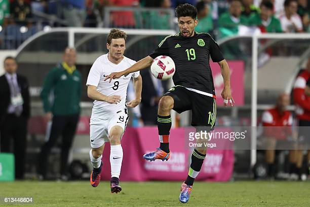 Oribe Peralta of Mexico controls the ball while Michael McGlinchey of New Zealand observes during the International Friendly Match between Mexico and...