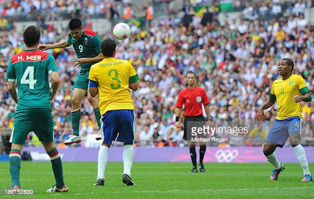 Oribe Peralta of Mexico scores his team's second goal during the Men's Football Final between Brazil and Mexico on Day 15 of the London 2012 Olympic...