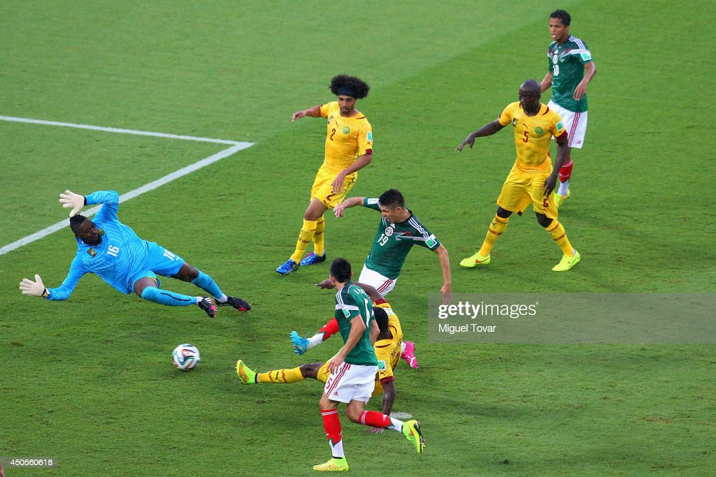 <a gi-track='captionPersonalityLinkClicked' href=/galleries/search?phrase=Oribe+Peralta&family=editorial&specificpeople=2496229 ng-click='$event.stopPropagation()'>Oribe Peralta</a> of Mexico shoots and scores a goal past <a gi-track='captionPersonalityLinkClicked' href=/galleries/search?phrase=Charles+Itandje&family=editorial&specificpeople=889524 ng-click='$event.stopPropagation()'>Charles Itandje</a> of Cameroon in the second half during the 2014 FIFA World Cup Brazil Group A match between Mexico and Cameroon at Estadio das Dunas on June 13, 2014 in Natal, Brazil.