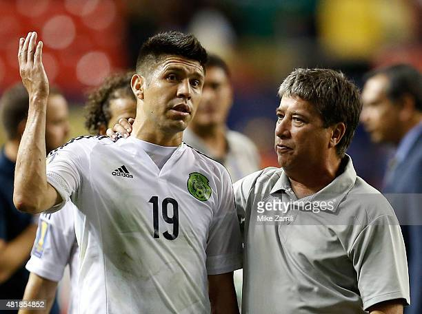 Oribe Peralta of Mexico talks with Panama head coach Hernan Gomez after the 2015 CONCACAF Gold Cup semifinal match at Georgia Dome on July 22 2015 in...