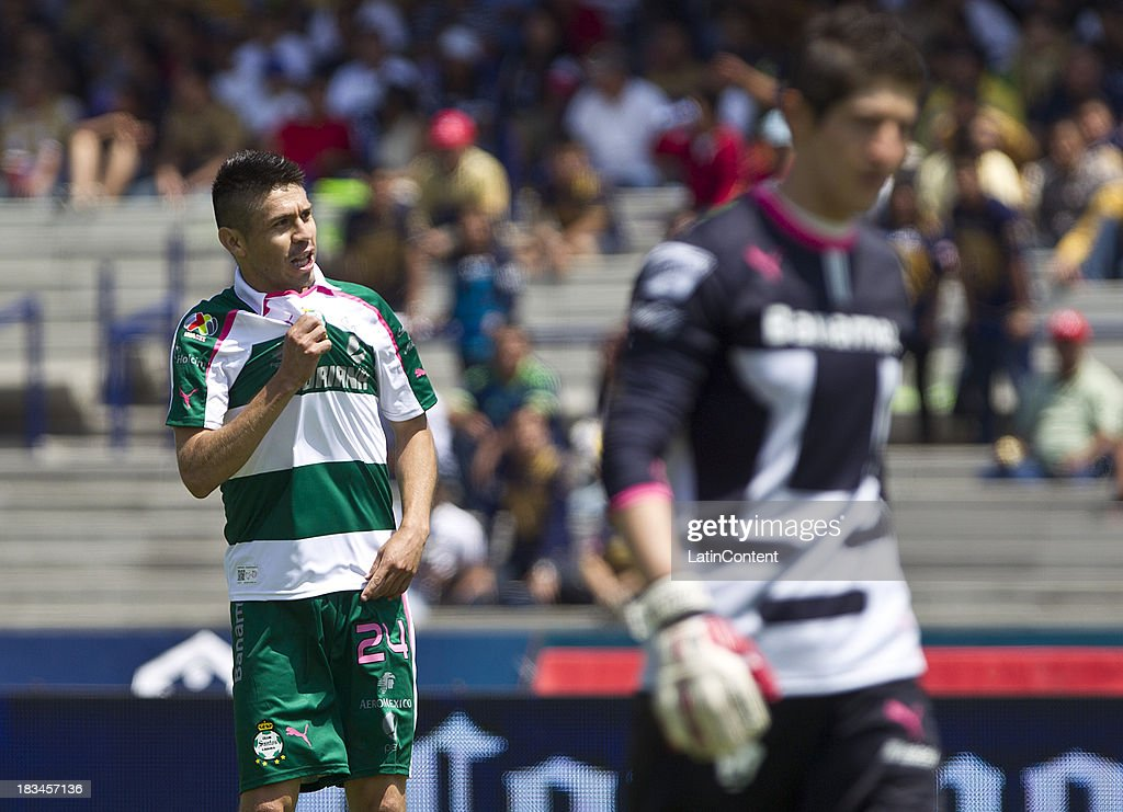 <a gi-track='captionPersonalityLinkClicked' href=/galleries/search?phrase=Oribe+Peralta&family=editorial&specificpeople=2496229 ng-click='$event.stopPropagation()'>Oribe Peralta</a> of Santos celebrates a scored goal against Pumas during a match between Pumas and Santos as part of the Apertura 2013 Liga MX at Olympic Stadium on October 06, 2013 in Mexico City, Mexico.