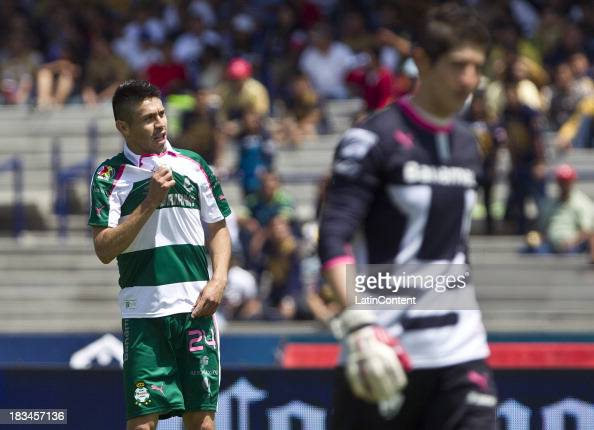 Oribe Peralta of Santos celebrates a scored goal against Pumas during a match between Pumas and Santos as part of the Apertura 2013 Liga MX at...
