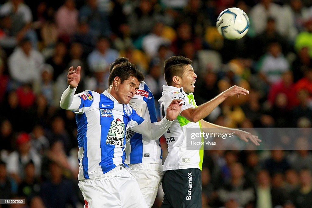 <a gi-track='captionPersonalityLinkClicked' href=/galleries/search?phrase=Oribe+Peralta&family=editorial&specificpeople=2496229 ng-click='$event.stopPropagation()'>Oribe Peralta</a> of Santos fights for the ball with Daniel Hernandez of Pachuca during a match between Pachuca and Santos as part of the Liga MX at Hidalgo stadium on September 21, 2013 in Pachuca, Mexico.