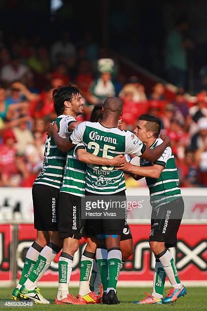 Oribe Peralta of Santos Laguna celebrates with his teammates the second goal of his team during a match between Veracruz and Santos Laguna as part of...