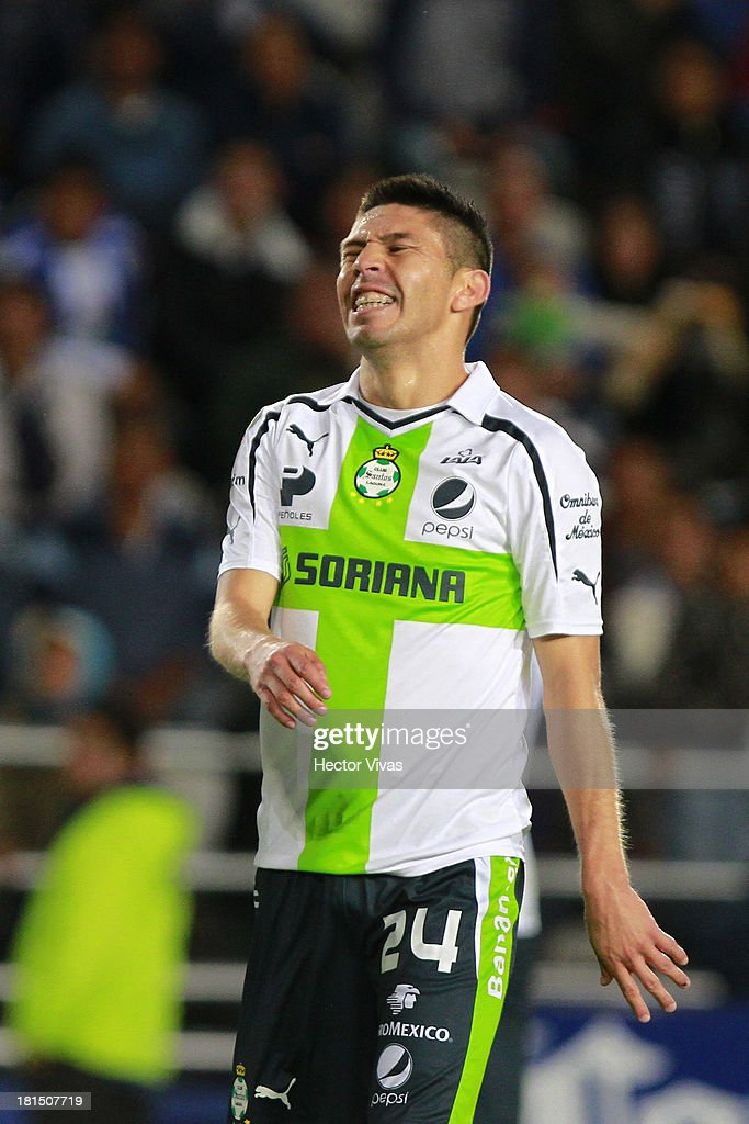 <a gi-track='captionPersonalityLinkClicked' href=/galleries/search?phrase=Oribe+Peralta&family=editorial&specificpeople=2496229 ng-click='$event.stopPropagation()'>Oribe Peralta</a> of Santos reacts during a match between Pachuca and Santos as part of the Liga MX at Hidalgo stadium on September 21, 2013 in Pachuca, Mexico.