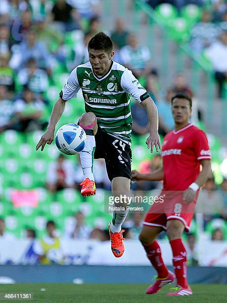 Oribe Peralta of Santos receives the ball during a match between Santos Laguna and Toluca as part of the Clausura 2014 Liga MX at Corona Stadium on...