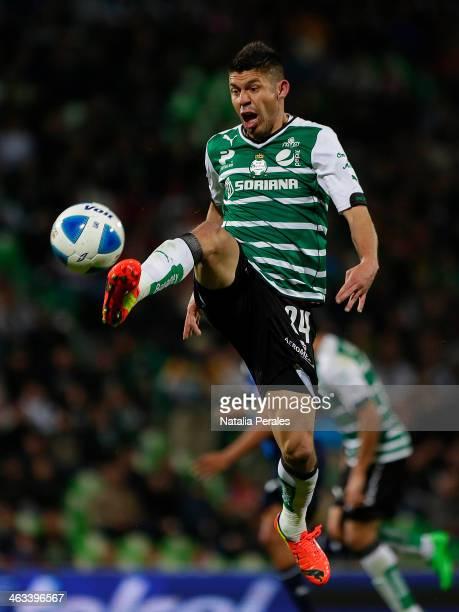 Oribe Peralta of Santos tries to control the ball during a match between Santos Laguna and Puebla as part of the Clausura 2014 Liga MX at Corona...