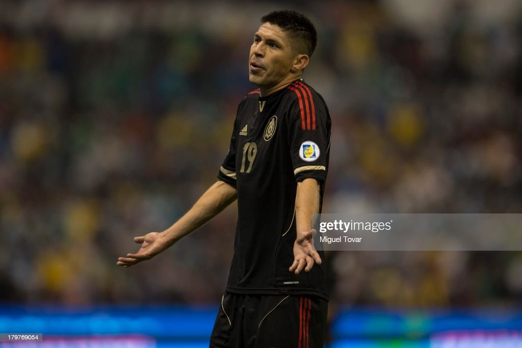 <a gi-track='captionPersonalityLinkClicked' href=/galleries/search?phrase=Oribe+Peralta&family=editorial&specificpeople=2496229 ng-click='$event.stopPropagation()'>Oribe Peralta</a> reacts during a match between Mexico and Honduras as part of the 15th round of the South American Qualifiers at Azteca Stadium on September 06, 2013 in Mexico City, Mexico.