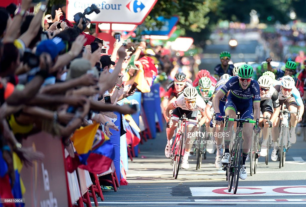 TOPSHOT - Orica Bikeexchange's Belgian cyclist Jens Keukeleire crosses the finish line to win the 12th stage of the 71st edition of 'La Vuelta' Tour of Spain, a 193.2km route between Los Corrales de Buelna and Bilbao, on September 1, 2016. / AFP / JOSE