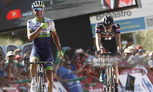 Orica GreenEdge Colombian cyclist Esteban Chaves Rubio celebrates as he crosses the finish line during the second stage of the 2015 Vuelta Espana...