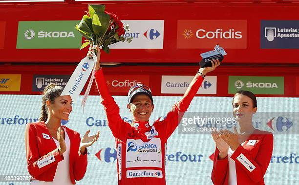 Orica GreenEdge's Colombian cyclist Esteban Chaves celebrates his red jersey on the podium of the sixth stage of the 2015 Vuelta Espana cycling tour...