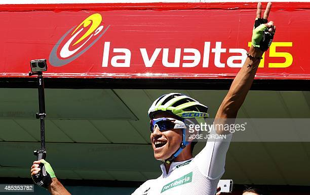 Orica GreenEdge's Colombian cyclist Esteban Chaves Rubio flashes he victory sign prior to the start of the sixth stage of the 2015 Vuelta Espana...