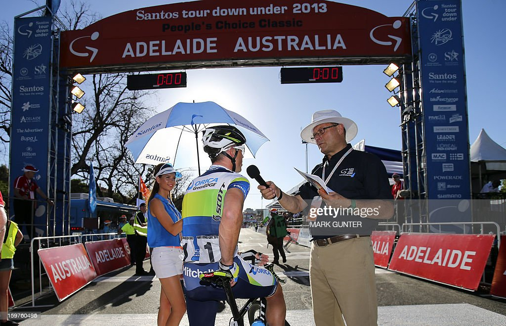 Orica-GreenEdge's Simon Gerrans (C) of Australia is interviewed before the start of the 51km People's Choice Classic prior to the Tour Down Under in Adelaide on January 20, 2013. The six-stage Tour Down Under takes place from January 20 to 27. AFP PHOTO / Mark Gunter USE