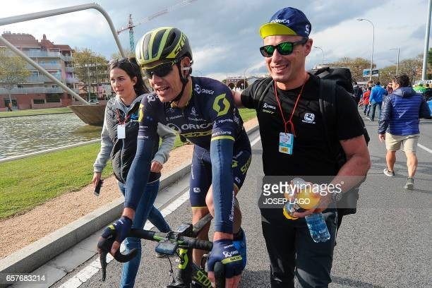 Orica's South African cyclist Daryl Impey celebrates his victory after the finish line on the sixth day of the 97th Volta Catalunya 2017 a 1897km...