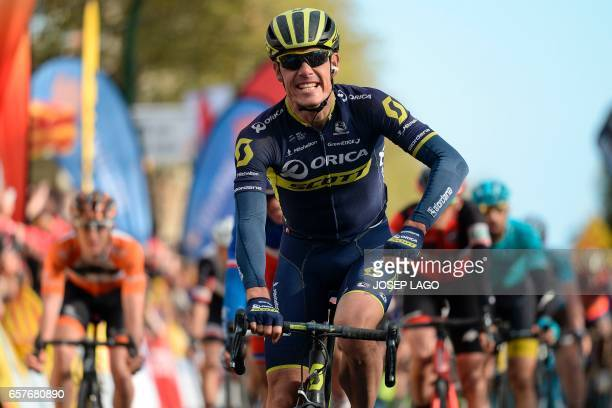 Orica's South African cyclist Daryl Impey celebrates his victory on the finish line on the sixth day of the 97th Volta Catalunya 2017 a 1897km stage...