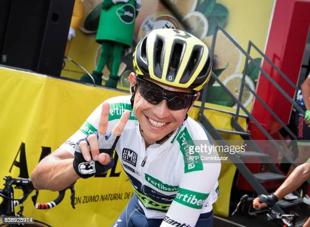 OricaScott team's Colombian Esteban Chaves flashes the Victory sign prior to the start of the 7th stage of the 72nd edition of 'La Vuelta' Tour of...